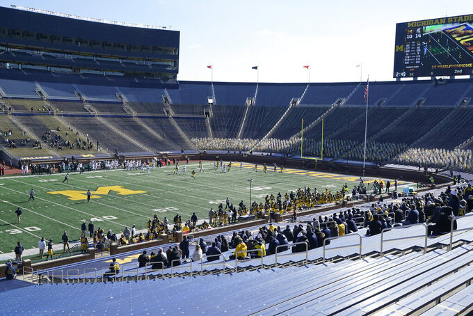 Michigan and Michigan State play during the first half of an NCAA college football game, Saturday, Oct. 31, 2020, in Ann Arbor, Mich. (AP Photo/Carlos Osorio)
