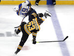 St. Louis Blues' Ivan Barbashev, rear, of Russia, and Boston Bruins' Brad Marchand collide during the first period in Game 7 of the NHL hockey Stanley Cup Final, Wednesday, June 12, 2019, in Boston. (AP Photo/Charles Krupa)