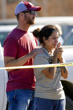 Family members react at the scene of a fatal shooting in the parking lot of a Walmart in Duncan, Okla., on Monday, Nov. 18, 2019. (Chris Landsberger/The Oklahoman via AP)