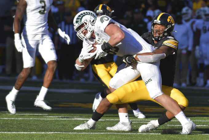 Iowa linebacker Jestin Jacobs (5) tackles Colorado State tight end Trey McBride (85) during the second half of an NCAA college football game, Saturday, Sept. 25, 2021, in Iowa City, Iowa. (AP Photo/Ron Johnson)