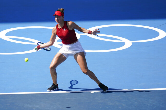 Belinda Bencic, of Switzerland, returns to Anastasia Pavlyuchenkova, of the Russian Olympic Committee, during the quarterfinal round of the women's tennis competition at the 2020 Summer Olympics, Wednesday, July 28, 2021, in Tokyo, Japan. (AP Photo/Patrick Semansky)