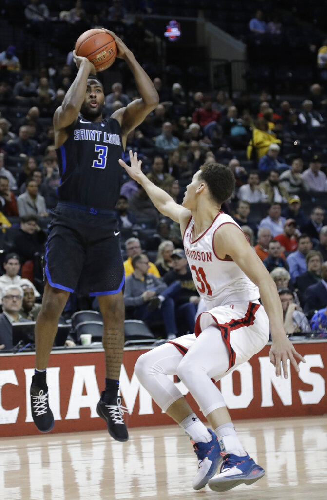 Saint Louis' Javon Bess (3) shoots over Davidson's Kellan Grady (31) during the second half of an NCAA college basketball game in the semifinal round of the Atlantic 10 men's tournament Saturday, March 16, 2019, in New York. Saint Louis won 67-44. (AP Photo/Frank Franklin II)