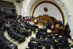Lawmaker Luis Parra, who broke with opposition leader Juan Guaido and claims the presidency of the National Assembly, leads a session at the National Assembly in Caracas, Venezuela, Tuesday, Jan. 21, 2020. (AP Photo/Matias Delacroix)