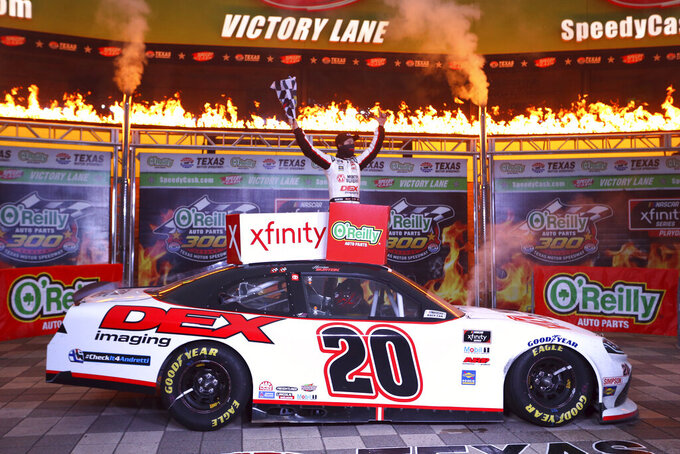 Harrison Burton (20) celebrates in Victory Lane after winning a NASCAR Xfinity Series auto race at Texas Motor Speedway in Fort Worth, Texas, Saturday, Oct. 24, 2020. (AP Photo/Richard W. Rodriguez)