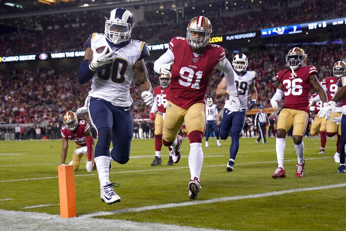 Los Angeles Rams running back Todd Gurley II (30) runs for a touchdown against the San Francisco 49ers during the first half of an NFL football game in Santa Clara, Calif., Saturday, Dec. 21, 2019. (AP Photo/Tony Avelar)