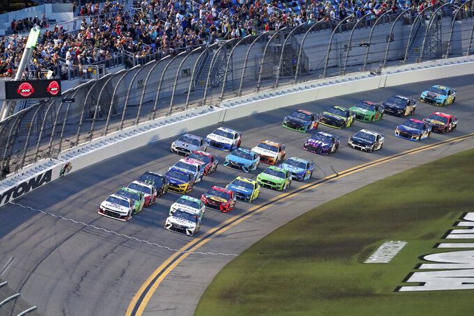 William Byron, front left, and Denny Hamlin, front right, lead the field to start the NASCAR Cup Series auto race at Daytona International Speedway, Saturday, Aug. 28, 2021, in Daytona Beach, Fla. (AP Photo/David Graham)