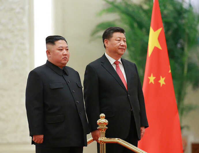 FILE - In this Jan. 8, 2019, file photo provided by the North Korean government, North Korean leader Kim Jong Un, left, and Chinese President Xi Jinping attend a welcome ceremony at the Great Hall of the People in Beijing. Xi said North Korea is taking the