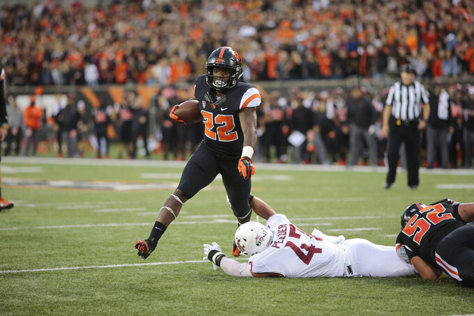 FILE - In this Oct. 6, 2018, file photo, Oregon State running back Jermar Jefferson (22) carries the ball against Washington State during an NCAA college football game in Corvallis, Ore. The Pac-12 freshman of the year, lured out of southern California, delivered seven 100-yard games, including 254 and two touchdowns against Arizona State. The Beavers finished 2-10 and are probably still another year away from even thinking about a postseason push. (AP Photo/Timothy J. Gonzalez, File)