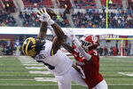 Michigan wide receiver Donovan Peoples-Jones (9) makes a touchdown reception against Indiana defensive back Tiawan Mullen (3) during the first half of an NCAA college football game, Saturday, Nov. 23, 2019, in Bloomington, Ind. (AP Photo/Darron Cummings)