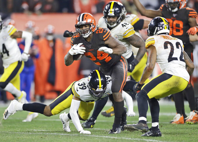 Cleveland Browns running back Nick Chubb (24) rushes during the second half of the team's NFL football game against the Pittsburgh Steelers, Thursday, Nov. 14, 2019, in Cleveland. The Browns won 21-7. (AP Photo/Ron Schwane)