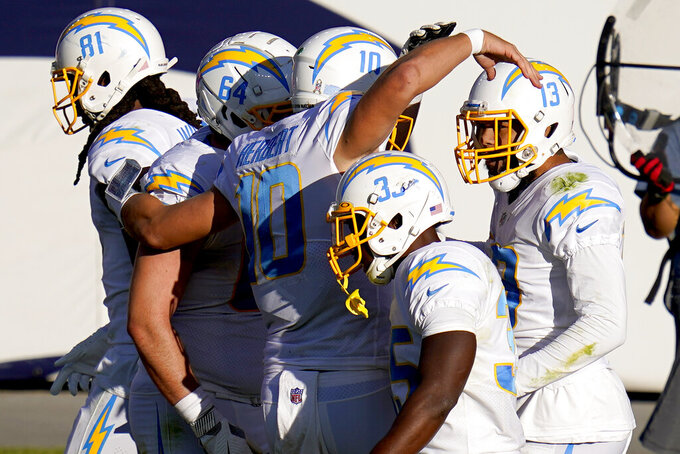 Los Angeles Chargers wide receiver Keenan Allen (13) celebrates his touchdown with teammates during the first half of an NFL football game against the Denver Broncos, Sunday, Nov. 1, 2020, in Denver. (AP Photo/Jack Dempsey)