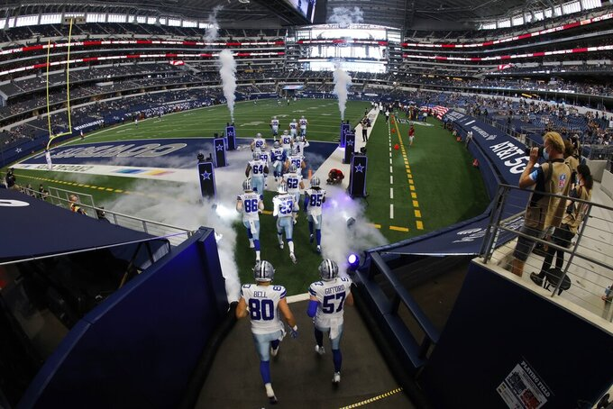 The Dallas Cowboys jog onto the field for the first half of an NFL football game against the New York Giants at AT&T Stadium in Arlington, Texas, Sunday, Oct. 11, 2020. (AP Photo/Ron Jenkins)