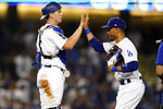 Los Angeles Dodgers' Will Smith, left, and Mookie Betts congratulate one another after the Dodgers' 5-2 win over the Colorado Rockies in a baseball game Saturday, Aug. 28, 2021, in Los Angeles. (AP Photo/Marcio Jose Sanchez)