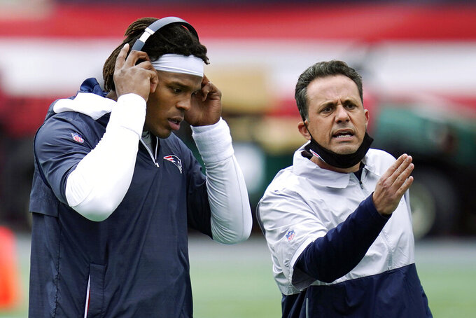FILE - In this Oct. 26, 2020, file photo, New England Patriots quarterback Cam Newton, left, stands beside quarterback coach Jedd Fisch before an NFL football game against the San Francisco 49ers in Foxborough, Mass. Arizona is hiring New England Patriots assistant Jedd Fisch as its head coach, a person with knowledge of the situation told The Associated Press on Wednesday, Dec. 23, 2020. Fisch is filling the vacancy created when Arizona fired Kevin Sumlin earlier this month after the Wildcats finished the season winless, according to the person who spoke to the AP on condition of anonymity because the school was still preparing an official announcement. (AP Photo/Charles Krupa, File)