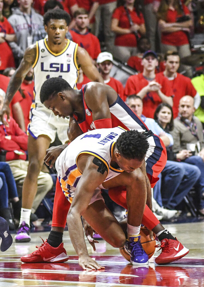 LSU guard Javonte Smart (1) and Mississippi guard Bryce Williams go for the ball during an NCAA college basketball game in Oxford, Miss., Saturday, Jan. 18, 2020. (Bruce Newman/The Oxford Eagle via AP)