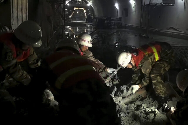 In this photo released by Xinhua News Agency, rescuers search for survivors at a collapsed tunnel in Lincang City, southwest China's Yunnan Province, Wednesday, Nov. 27, 2019. A highway tunnel under construction in southwestern China has collapsed, killing several people and leaving another eight missing, authorities said Wednesday. (Yan Hua/Xinhua via AP)
