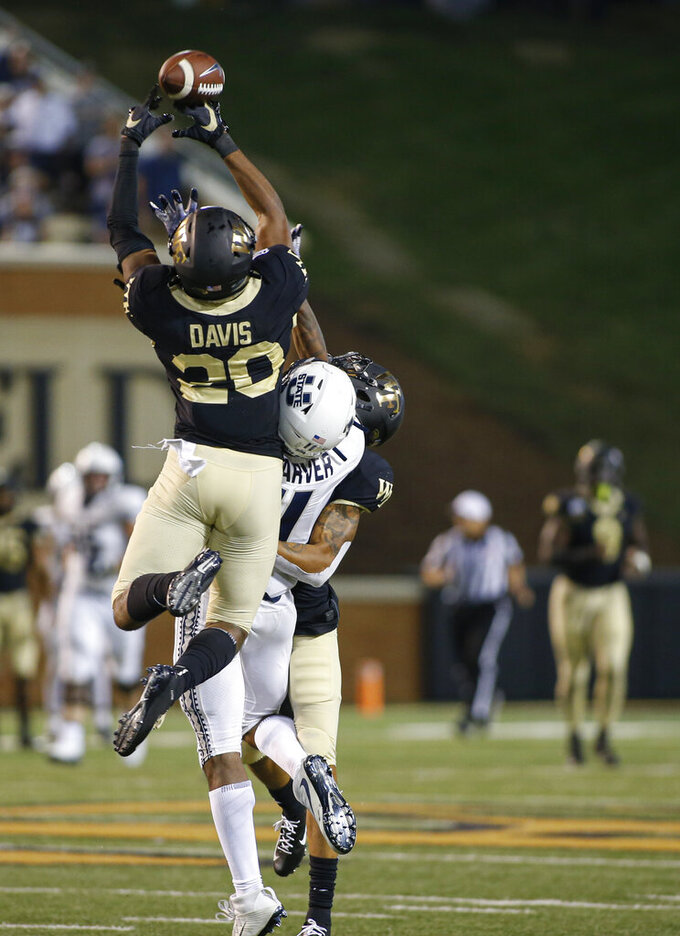 Wake Forest defensive back Coby Davis (20) breaks up a pass intended for Utah State wide receiver Savon Scarver in the closing seconds of an NCAA college football game in Winston-Salem, N.C., Friday, Aug. 30, 2019. Wake Forest won 38-35. (AP Photo/Nell Redmond)
