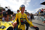 Netherlands' Mike Teunissen of the Team Jumbo Visma, wearing the overall leader's yellow jersey, celebrates following the second stage of the Tour de France cycling race, a team time trial over 27.6 kilometers (17 miles) with start and finish in Brussels, Belgium, Sunday, July 7, 2019. (AP Photo/ Christophe Ena)
