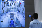 In this photo released by Xinhua News Agency, a worker monitors screens showing the interior of the Tianhe space station module after Chinese astronauts docked and enter it are displayed on large screens at the Beijing Aerospace Control Center in Beijing, on Thursday, June 17, 2021. China has launched the first three-man crew to its new space station in its the ambitious programs first crewed mission in five years (Jin Liwang/Xinhua via AP)