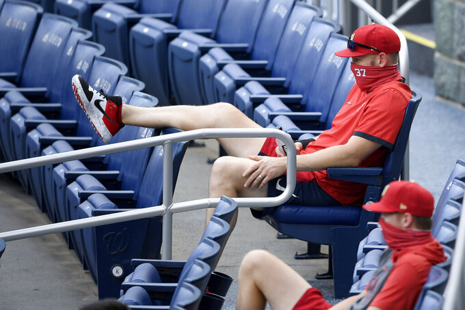 Washington Nationals' Stephen Strasburg (37) watches from the stands during the first inning of a baseball game against the Toronto Blue Jays, Tuesday, July 28, 2020, in Washington. (AP Photo/Nick Wass)