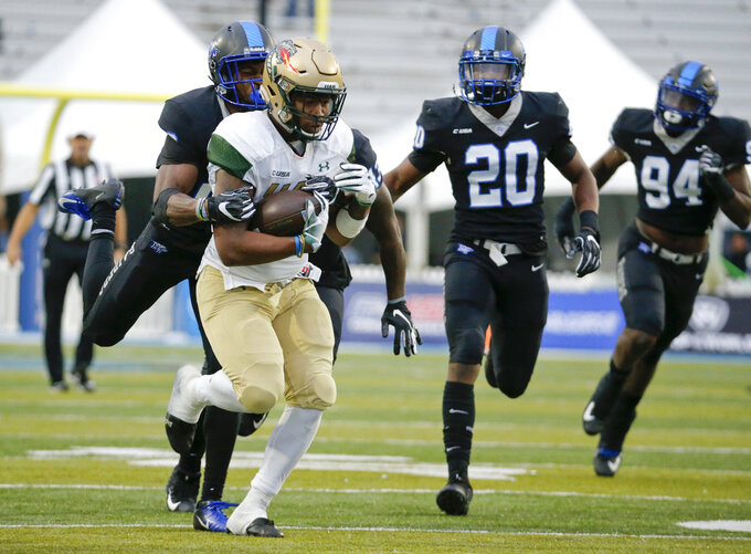 UAB running back Spencer Brown, front left, carries the ball against Middle Tennessee during the second half of the Conference USA championship NCAA college football game Saturday, Dec. 1, 2018, in Murfreesboro, Tenn. UAB won 27-25. (AP Photo/Mark Humphrey)