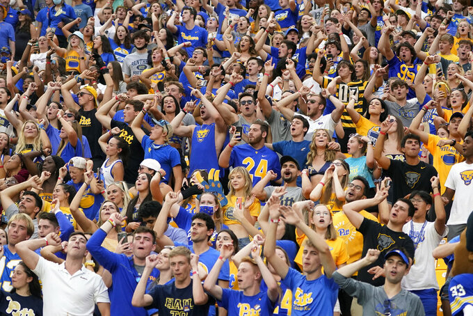 Pittsburgh fans cheer at the start of the fourth quarter during an NCAA college football game between Pittsburgh and Massachusetts, Saturday, Sept. 4, 2021, in Pittsburgh. Pittsburgh won 51-7.(AP Photo/Keith Srakocic)