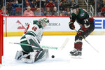 Minnesota Wild goaltender Devan Dubnyk (40) makes the save against Arizona Coyotes center Carl Soderberg in the second period during an NHL hockey game, Saturday, Nov. 9, 2019, in Glendale, Ariz. (AP Photo/Rick Scuteri)