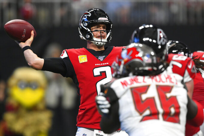 Atlanta Falcons quarterback Matt Ryan (2) works in the pocket against the Tampa Bay Buccaneers during the first half of an NFL football game, Sunday, Nov. 24, 2019, in Atlanta. (AP Photo/John Amis)