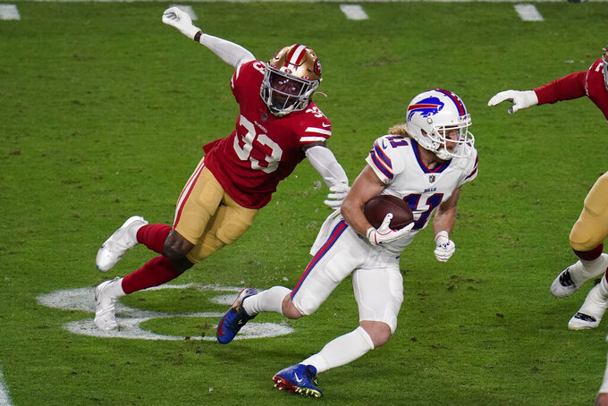 Buffalo Bills wide receiver Cole Beasley (11) tries to escape the reach of San Francisco 49ers defensive back Tarvarius Moore (33) during the first half of an NFL football game, Monday, Dec. 7, 2020, in Glendale, Ariz. (AP Photo/Ross D. Franklin)