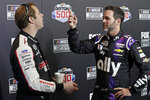 Brad Keselowski, left, and Jimmie Johnson talk between interviews during NASCAR Daytona 500 auto racing media day at Daytona International Speedway, Wednesday, Feb. 12, 2020, in Daytona Beach, Fla. (AP Photo/John Raoux)