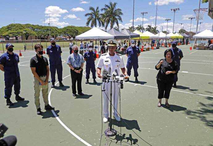 FILE - In this Aug. 27, 2020 file photo U.S. Surgeon General Vice Adm. Jerome Adams speaks during a press conference on the second day of surge COVID-19 testing, at Kalakaua District Park in Honolulu. Adams who was cited for being in a closed Hawaii park in August while in the islands helping with surge testing amid a spike in coronavirus cases, appears for a virtual arraignment in a Hawaii court on Wednesday, Oct. 21, 2020. (Jamm Aquino/Honolulu Star-Advertiser via AP,File)