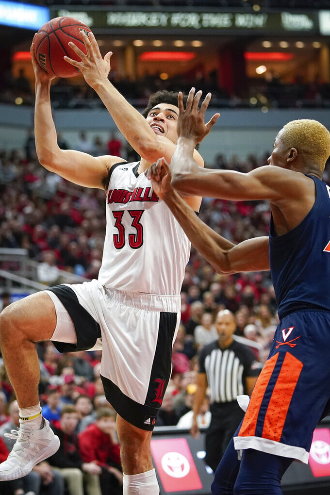 Louisville forward Jordan Nwora (33) shoots the ball during the second half of an NCAA college basketball game against Virginia, Saturday, Feb 8, 2020 in Louisville, Ky. (AP Photo/Bryan Woolston)