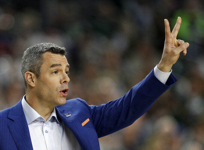 Virginia head coach Tony Bennett directs his team during the first half in the semifinals of the Final Four NCAA college basketball tournament against Auburn, Saturday, April 6, 2019, in Minneapolis. (AP Photo/David J. Phillip)