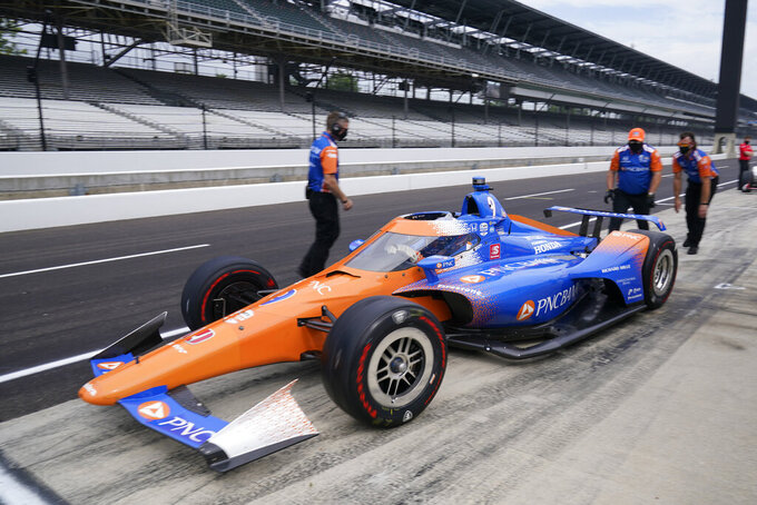 Scott Dixon, of New Zealand, pulls out fo the pits during a practice session for the Indianapolis 500 auto race at Indianapolis Motor Speedway, Wednesday, Aug. 12, 2020, in Indianapolis. (AP Photo/Darron Cummings)