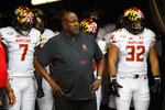 FILE - In this Sept. 14, 2019, file photo, Maryland head coach Michael Locksley, center, looks on as he is about to lead his team out of the tunnel for the first half of an NCAA college football against Temple, in Philadelphia. One year ago, Maryland took Ohio State into overtime before a failed 2-point conversion resulted in a 52-51 defeat. In the rematch Saturday, the Terrapins are a 43-point underdog. (AP Photo/Chris Szagola, File)