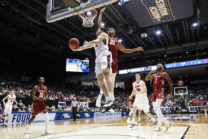 Belmont's Grayson Murphy, center left, shoots against Temple's Justyn Hamilton (21) during the first half of a First Four game of the NCAA college basketball tournament, Tuesday, March 19, 2019, in Dayton, Ohio. (AP Photo/John Minchillo)