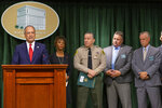 U.S. Attorney Nick Hanna, from left, at podium, with Los Angeles County District Attorney, Jackie Lacey, Sheriff Alex Villanueva, Chief-Detective Division Lt. Pat Nelson, and Homicide Bureau Capt. Kent Wegener listen to questions at a news conference about the arrest of Ed Buck, the prominent LGBTQ political activist, in Los Angeles, Thursday, Sept. 19, 2019. Federal prosecutors will ask a judge to hold Buck without bond pending his trial on charges connected to a drug death at his Los Angeles-area home. (AP Photo/Damian Dovarganes)