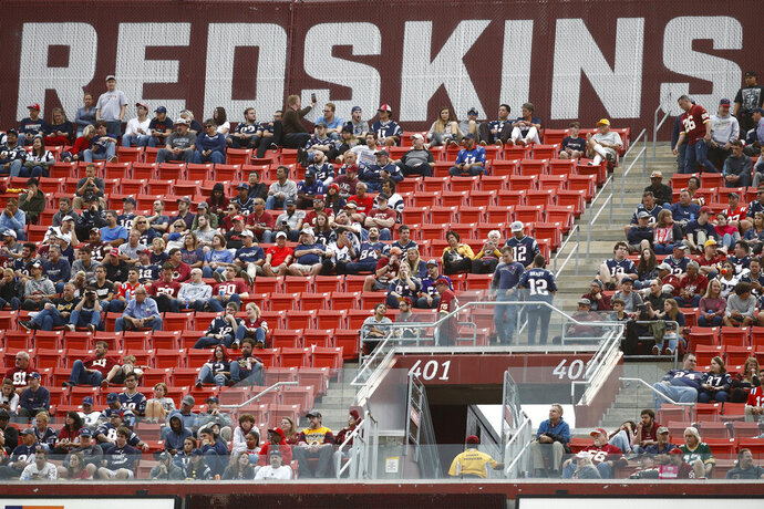 FILE - In this Oct. 6, 2019, file photo, fans watch play between the Washington Redskins and the New England Patriots during the second half of an NFL football game, in Landover, Md. There were more than 20,000 empty seats for the Redskins' last home game, and when many of them have been filled this season, it's with fans of the visiting team. It could be even emptier Sunday when the 1-9 Redskins host the 3-6-1 Detroit Lions. (AP Photo/Patrick Semansky, File)