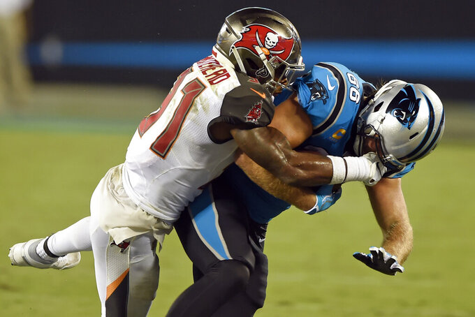 Tampa Bay Buccaneers free safety Jordan Whitehead (31) tackles Carolina Panthers tight end Greg Olsen during the first half of an NFL football game in Charlotte, N.C., Thursday, Sept. 12, 2019. (AP Photo/Mike McCarn)
