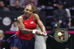 United States' Serena Williams returns a shot from Latvia's Jelena Ostapenko during a Fed Cup qualifying tennis match Friday, Feb. 7, 2020, in Everett, Wash. (AP Photo/Elaine Thompson)
