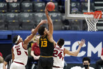 Missouri's Mark Smith (13) drives to the basket against Arkansas' Moses Moody (5) and Ethan Henderson (24) in the first half of an NCAA college basketball game in the Southeastern Conference Tournament Friday, March 12, 2021, in Nashville, Tenn. (AP Photo/Mark Humphrey)