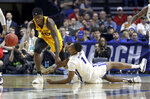 Buffalo's Montell McRae (1) and Arizona State's Zylan Cheatham (45) chase a loose ball during the first half of a first-round game in the NCAA men's college basketball tournament, Friday, March 22, 2019, in Tulsa, Okla. (AP Photo/Jeff Roberson)