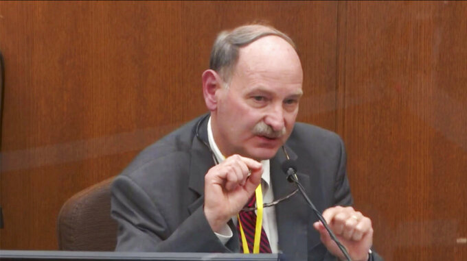 In this image taken from video, witness Dr. Bill Smock, a Louisville physician in forensic medicine, testifies as Hennepin County Judge PeterCahill presides, Thursday, April 8, 2021, in the trial of former Minneapolis police Officer Derek Chauvin at the Hennepin County Courthouse in Minneapolis. Chauvin is charged in the May 25, 2020, death of George Floyd. (Court TV via AP, Pool)