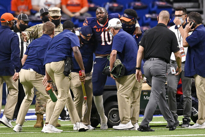 UTSA quarterback Lowell Narcisse (10) is helped onto a cart after suffering an injury during the second half of an NCAA college football game against Army on Saturday, Oct. 17, 2020, in San Antonio, Texas. Army won 28-16. (AP Photo/Darren Abate)