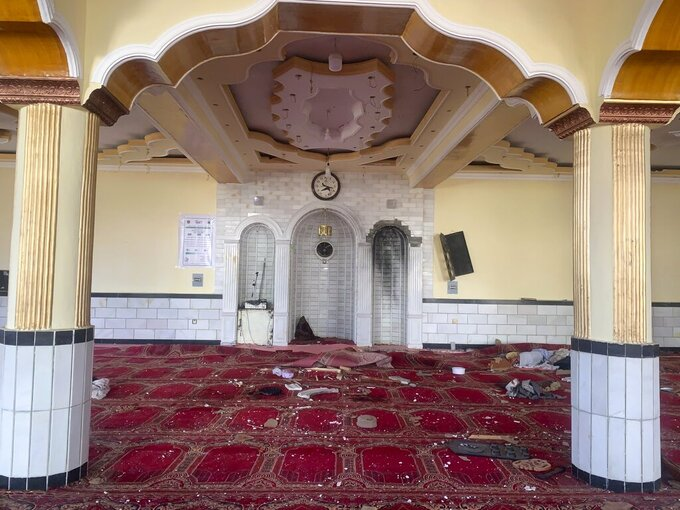 Debris covers the ground at a mosque after a bomb explosion in Shakar Dara district of Kabul, Afghanistan, Friday, May 14, 2021. A bomb ripped through a mosque in northern Kabul during Friday prayers killing 12 worshippers, Afghan police said. (AP Photo/Rahmat Gul)