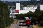 FILE - In this May 25, 2020 file photo, the Flins plant of French carmaker Renault is pictured in Aubergenville, west of Paris. French carmaker Renault announced 15,000 job cuts worldwide as part of a 2 billion euros cost-cutting plan over three years. Renault said on Friday that nearly 4,600 jobs would be cut in France in addition to more than 10,000 in the rest of the world. (AP Photo/Christophe Ena, File)