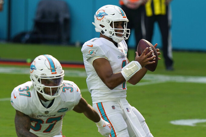 Miami Dolphins steps back before throwing his first touchdown pass, during the first half of an NFL football game against the Los Angeles Rams, Sunday, Nov. 1, 2020, in Miami Gardens, Fla. (AP Photo/Lynne Sladky)
