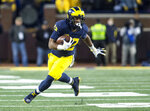 FILE - In this Nov. 3, 2018, file photo, Michigan running back Chris Evans carries during the team's NCAA college football game against Penn State in Ann Arbor, Mich. Evans announced Tuesday, Feb. 5, 2019, on Twitter he is going through academic issues, adding he will continue his career with the Wolverines. Evans posted the message shortly after the school announced he was not a member of the football team. (AP Photo/Tony Ding, File)