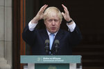 Britain's Prime Minister Boris Johnson gestures during a meeting with Ireland's Prime Minister Leo Varadkar at Government Buildings in Dublin, Monday Sept. 9, 2019. Boris Johnson is to meet with Leo Varadkar in search of a compromise on the simmering Brexit crisis. (Niall Carson/PA via AP)