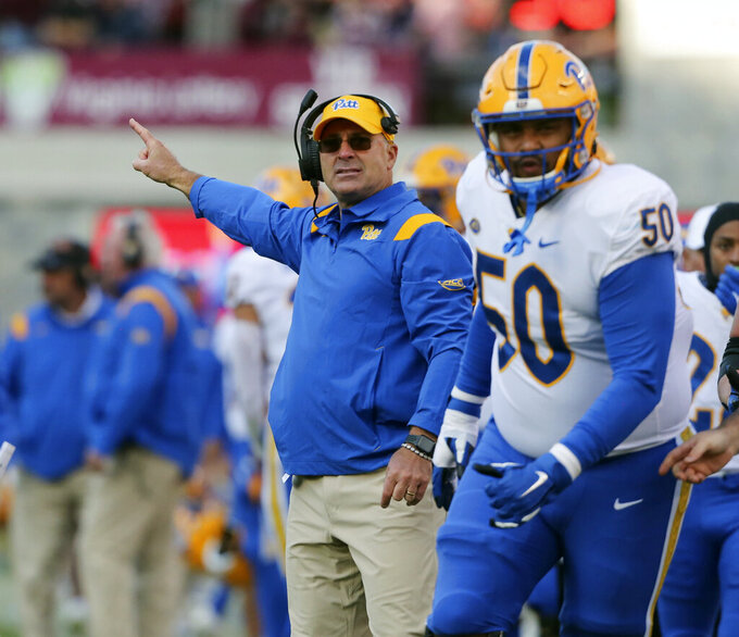 Pittsburgh head coach Pat Narduzzi points after a Pittsburgh touchdown in the first half of an NCAA college football game against Virginia Tech, Saturday, Oct. 16, 2021, in Blacksburg, Va. (Matt Gentry/The Roanoke Times via AP)